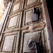 Ancient door of the church of the Holy Sepulcher, Jerusalem - Stock Photo