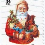 Santa with gift — Stock Photo