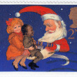 Children and Santa pulling a Christmas Cracker — Stock fotografie