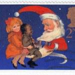 los niños y santa tirando una galleta de Navidad — Foto de Stock