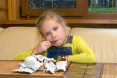 Girl with chocolates. — Stock Photo
