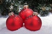 Christmas spheres on snow — Stock Photo