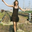 Beautiful Girl Walking on Rails — Stock Photo