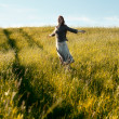 Happy woman in field — Stock Photo #7229200