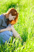 Redhead woman looking wound — Stock Photo