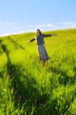 Happy woman in field — Stock Photo