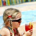 Child drinking orange juice. — Stock Photo
