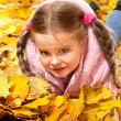Kid in autumn orange leaves. — Stock Photo #7110648