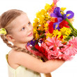 Happy child holding flowers. - Stockfoto