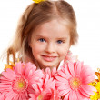 Happy child holding flowers. - Foto de Stock