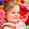 Cute child lying on the flower. - Stockfoto