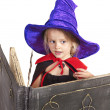 Witch child holding book. — Stock Photo