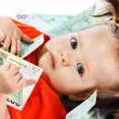 Child with euro money. — Stock Photo #7110733