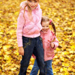 Kid in autumn orange leaves. — Stockfoto #7110763