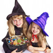 Stock Photo: Witch with trick or treat.