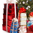 Christmas tree with stack gift box. — Stock Photo