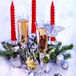 Christmas still life with champagne and candle. - Stockfoto