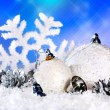 Christmas still life with snowflake and ball. — Stockfoto