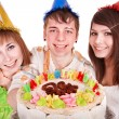 Stock Photo: Group of happy young with cake.