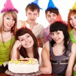 Group in party hat with cake. — Stock Photo