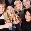 图库照片: Group young drinking champagne.