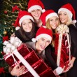 Group young in santa hat at nightclub. — Stock Photo #7111190