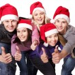 Group young in santa hat show thumbs up. — Stock Photo #7111212