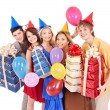 Group of young in party hat holding gift box. — Zdjęcie stockowe #7111234