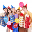 Group of young in party hat holding gift box. — Foto Stock #7111234