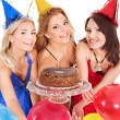 Foto Stock: Group holding cake.