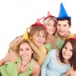 图库照片: Group of young in party hat.
