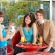 Happy family with child in cafe. — Stock Photo #7111330