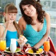 Stock Photo: Mother and daughter in restaurant.