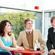 Group of happy talking in cafe. — Stock Photo #7111364