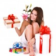Girl in spa with group of gift box and flower. — Stock Photo