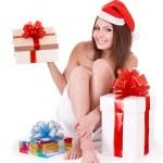 Girl in santa hat holding gift box. — Stock Photo #7111387