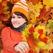Young woman in autumn orange leaves. — Stock Photo #7111437