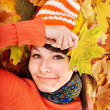 Royalty-Free Stock Photo: Girl in autumn orange leaves.
