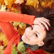 Girl in autumn orange leaves. — Stock Photo #7111449