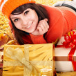 Girl in autumn outdoor holding gift box. — Stock Photo #7111463