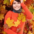 Young woman in autumn orange leaves. — Stock Photo #7111468