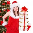 Christmas girl in santa hat holding stack gift box. — Stock Photo #7111473