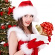 Girl in santa hat holding  gift box. - Stock Photo