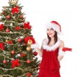 Christmas girl in santa holding gift box. — Stock Photo