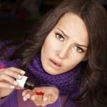 Girl having flu taking pills — Stock Photo #7111664