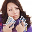 Girl having flu taking pills — Stock Photo #7111675