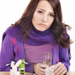 Girl having flu taking pills — Stock Photo #7111678