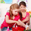 Children with teacher in play room. — Stock Photo #7111967