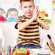 Stock Photo: Child with picture and brush in play room.