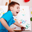Child with easel draw  hands. — Stock Photo